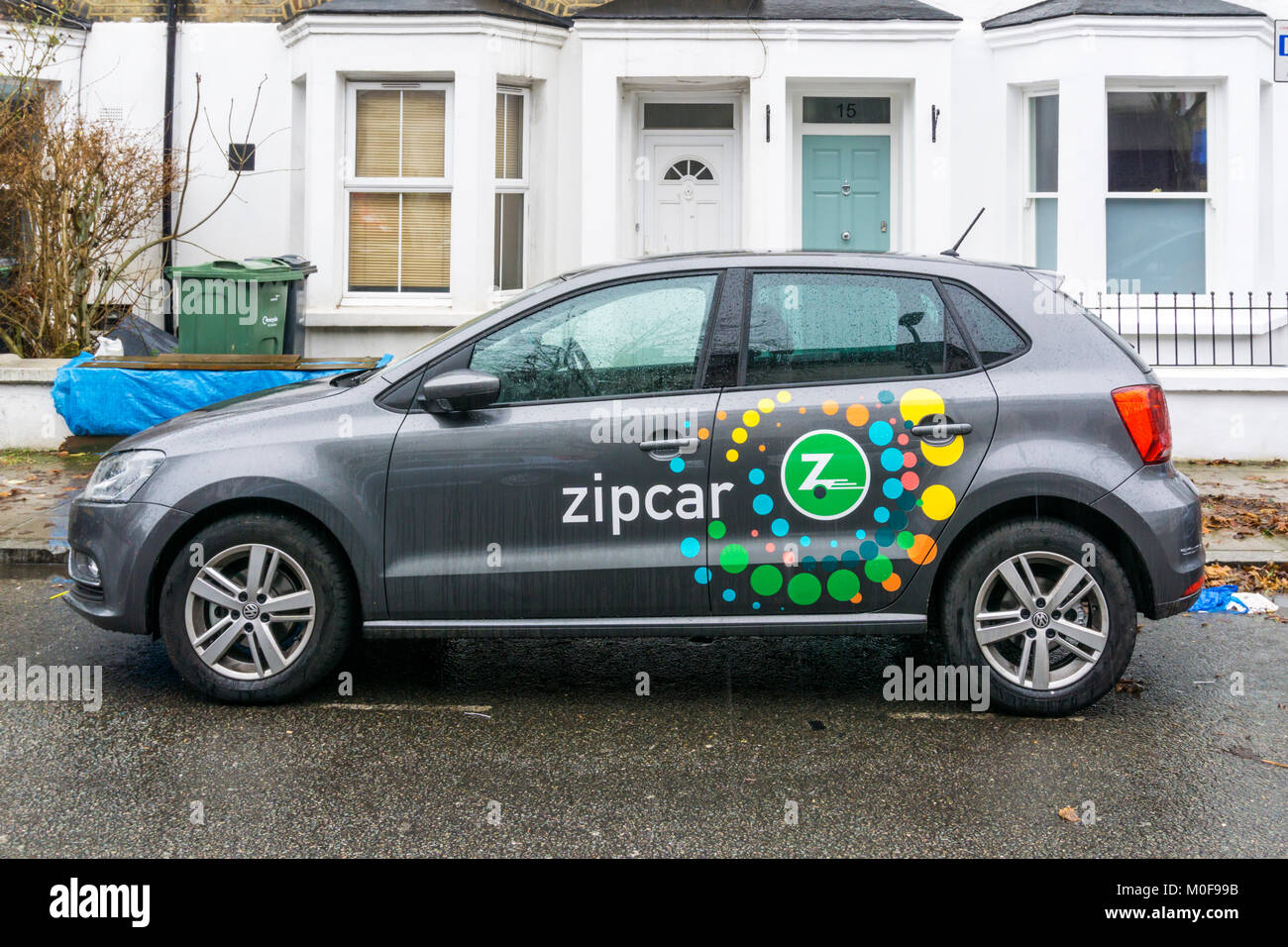 A VW Golf Zipcar in the rain in south London. - Stock Image