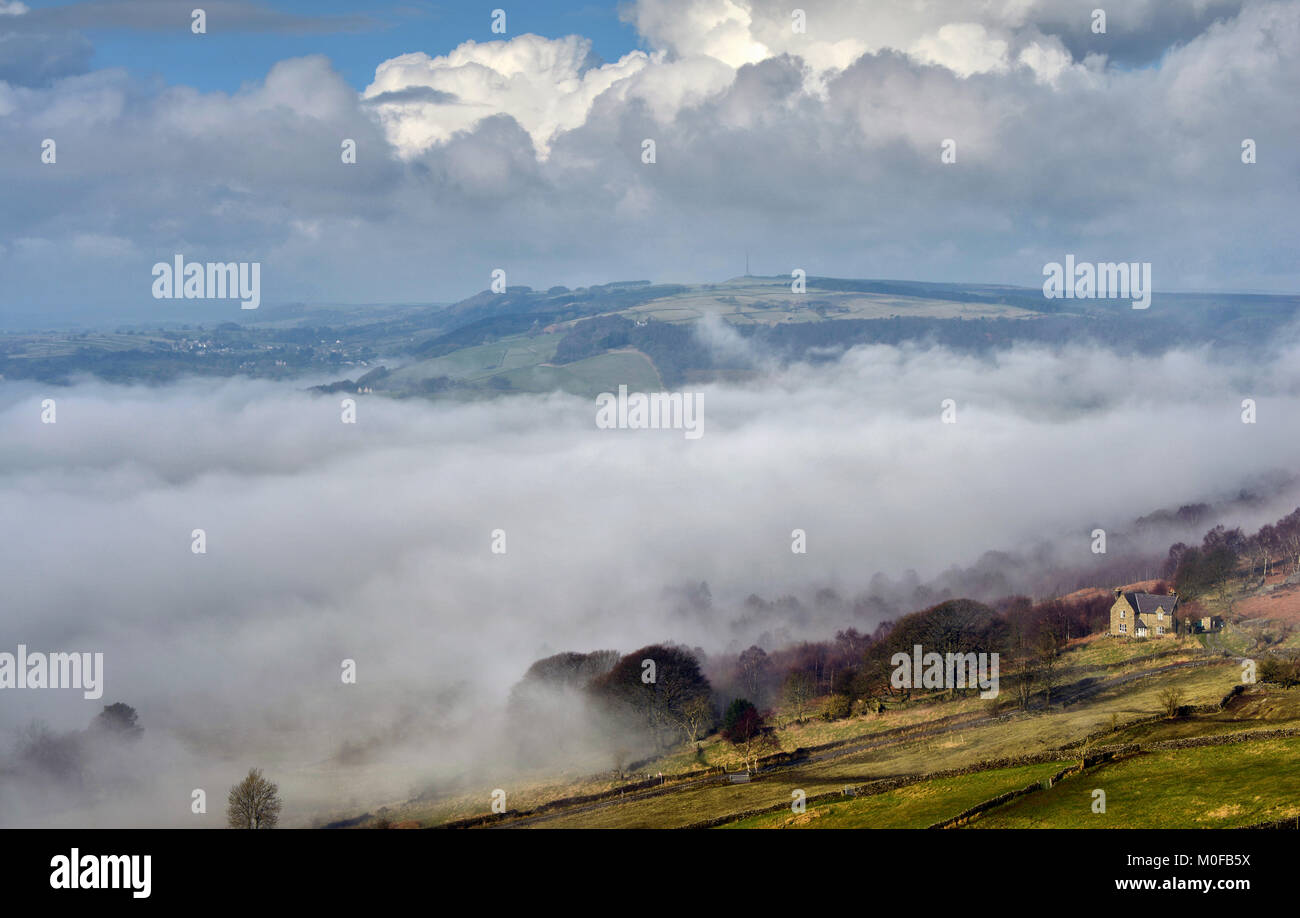 Mist in the valley from Curbar Edge - Stock Image