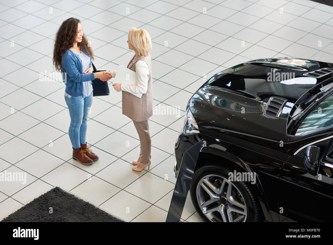 Firm Handshake of Customer and Consultant - Stock Image