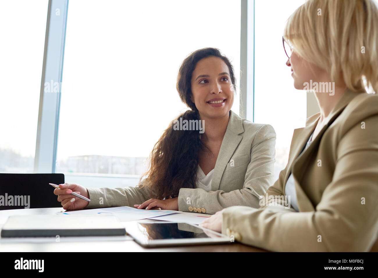 Sharing Creative Ideas with Coworker - Stock Image