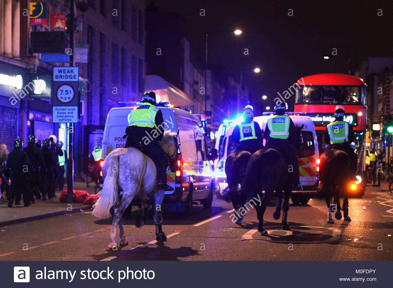 File photo dated 28/07/17 of riot police at a protest in Kingsland Road in east London, where people gathered in - Stock Image