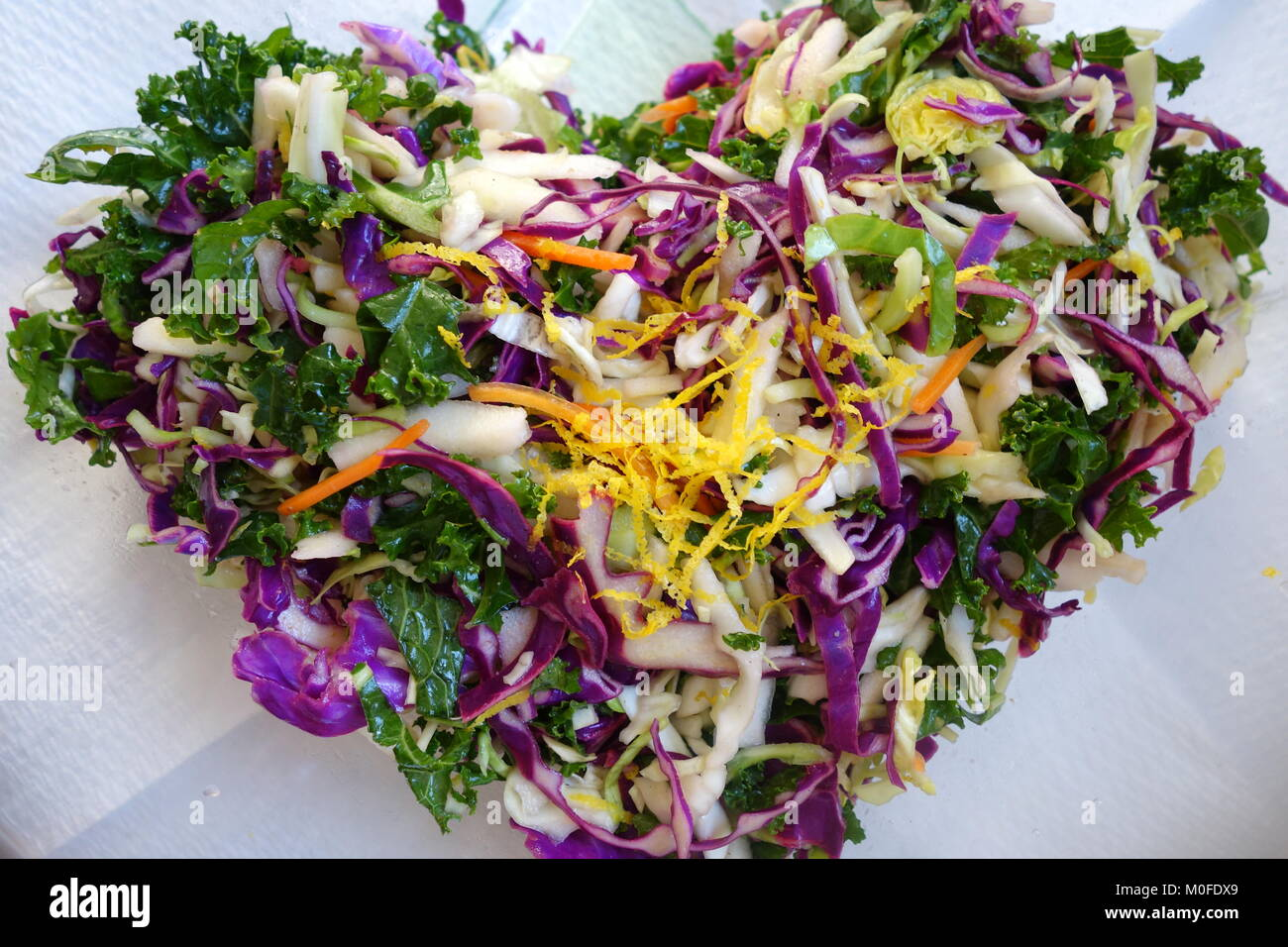 Heart shaped colorful mixed vegetables - Stock Image