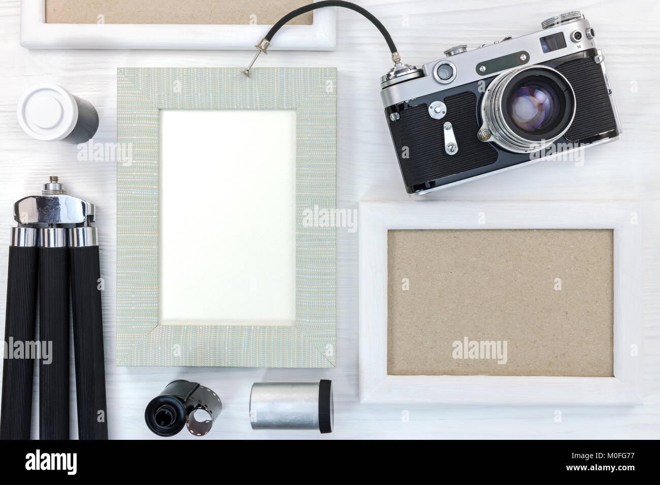 old memories concept - retro camera, empty photo frames, negative ...
