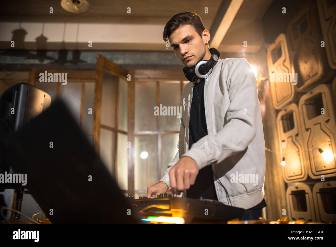 Young DJ Playing in Club - Stock Image
