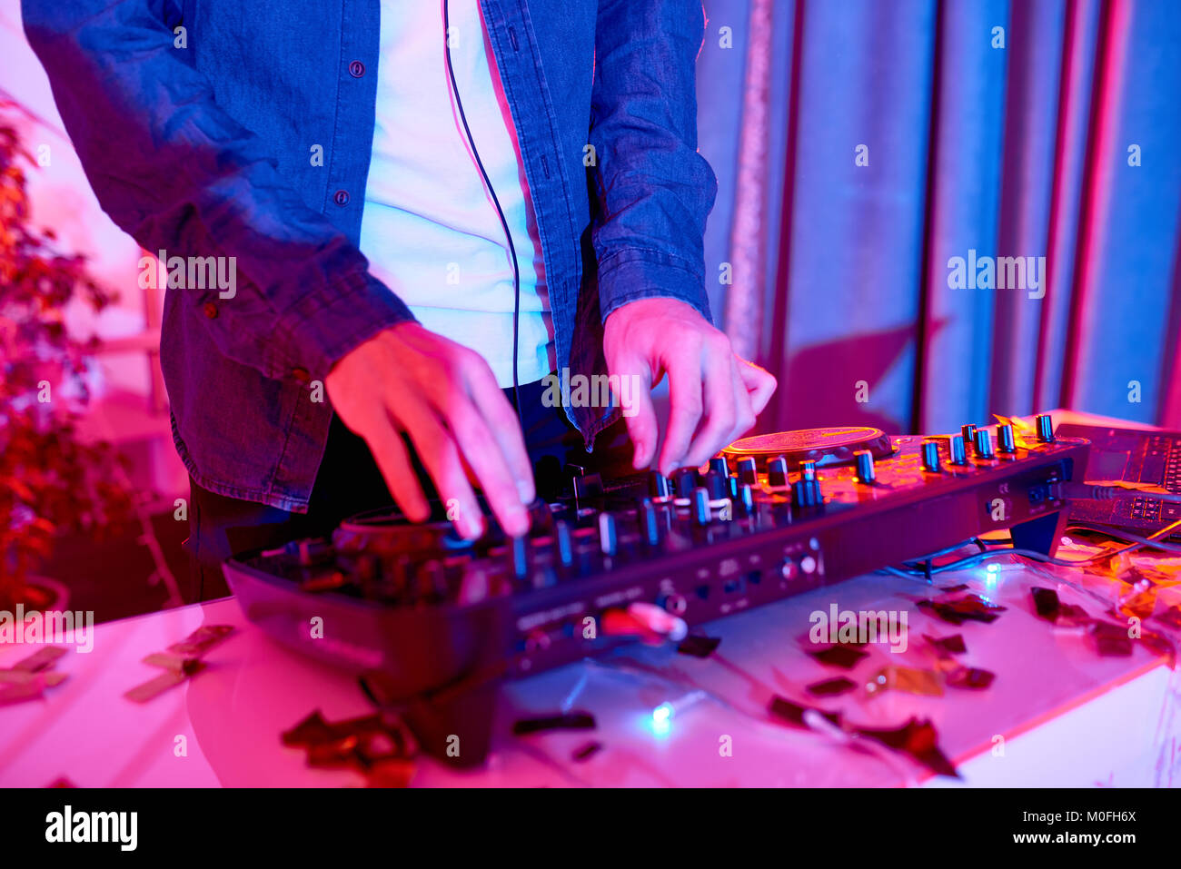 DJ Playing Music in Club - Stock Image