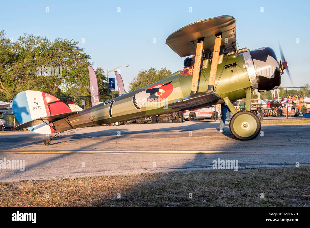 A traditional propellor driven plane, Nieuport 28, prepares for takeoff - Stock Image