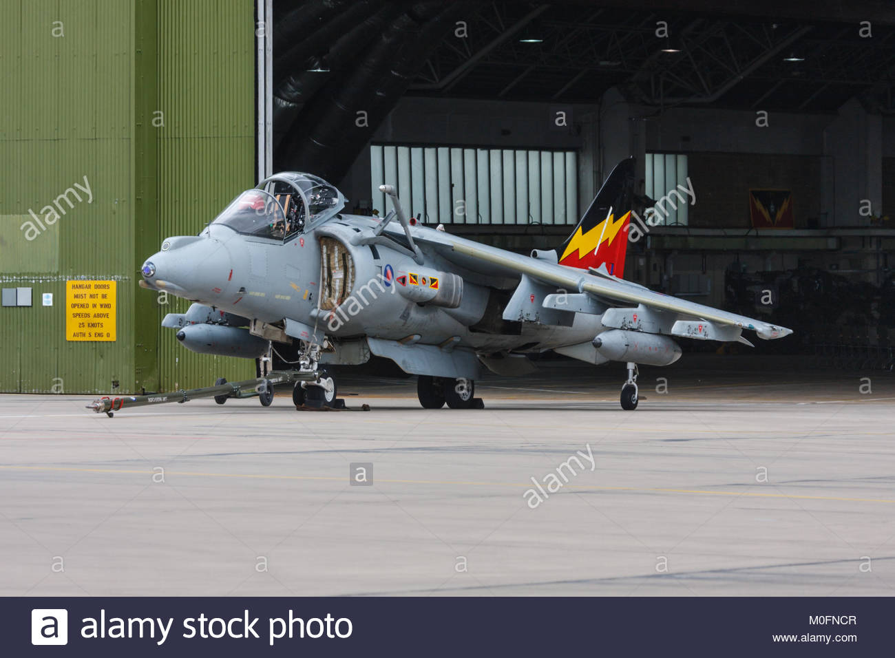 Bae Hawker Siddeley Harrier jet outside a hanger on RAF Wittering air base. Lincolnshire, England, UK - Stock Image