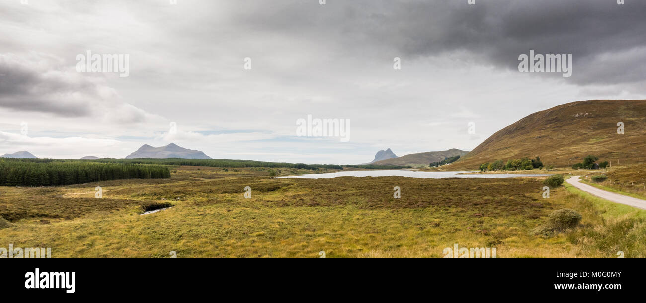 Suilven and Cul Mor mountains rise above the moorlands of Sutherland in Assynt in the Northwest Highlands of Scotland. - Stock Image