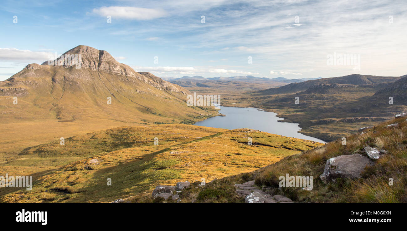 Cul Beag mountain rises beside Loch Lurgainn, seen from Stac Pollaidh in Inverpolly in the Northwest Highlands of - Stock Image