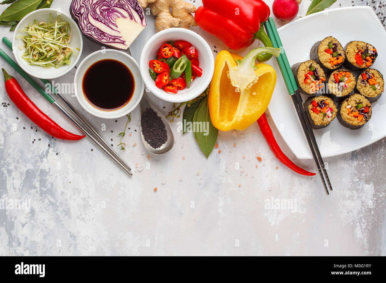 Vegan food background. Sushi rolls with quinoa, vegetables and sprouts. Ingredients for a healthy Vegetarian meal. - Stock Image