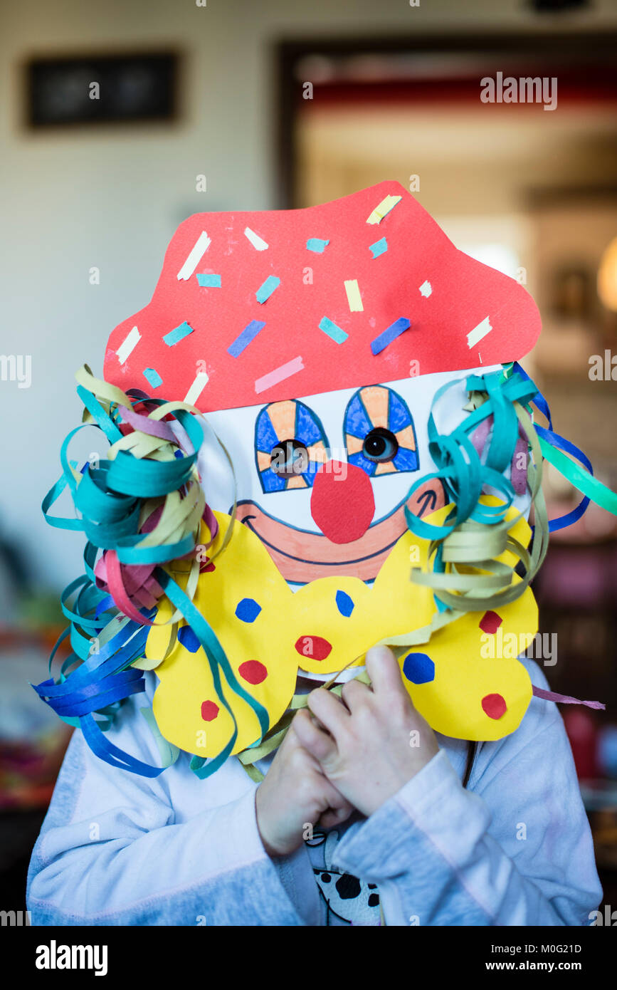 portrait of a 6 year old boy with a carnival mask made by himself at home - Stock Image