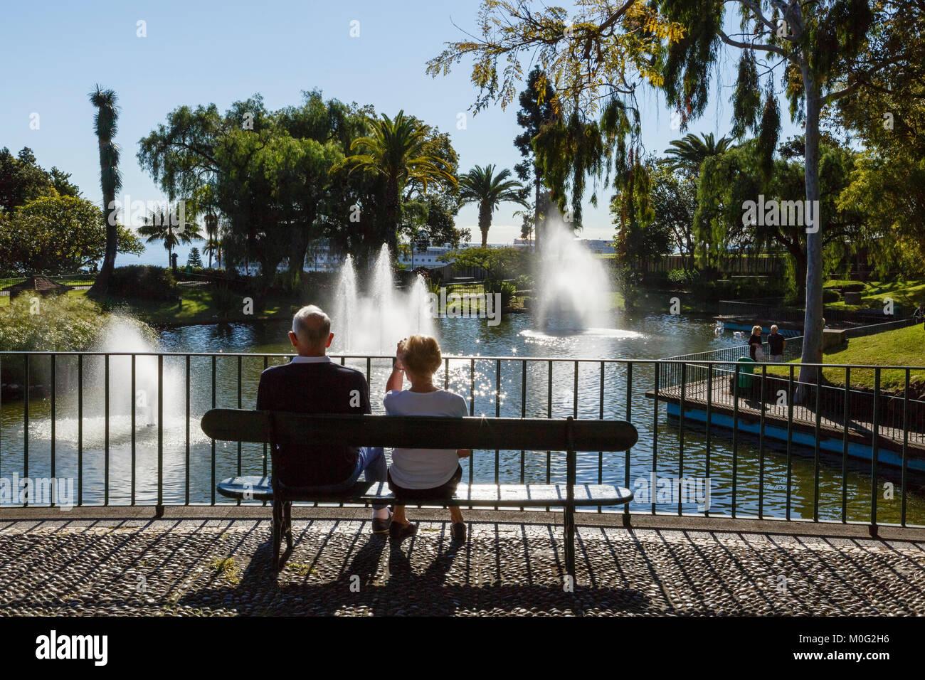 Couple relaxing in the sun at Santa Catarina Park, Funchal, Madeira - Stock Image