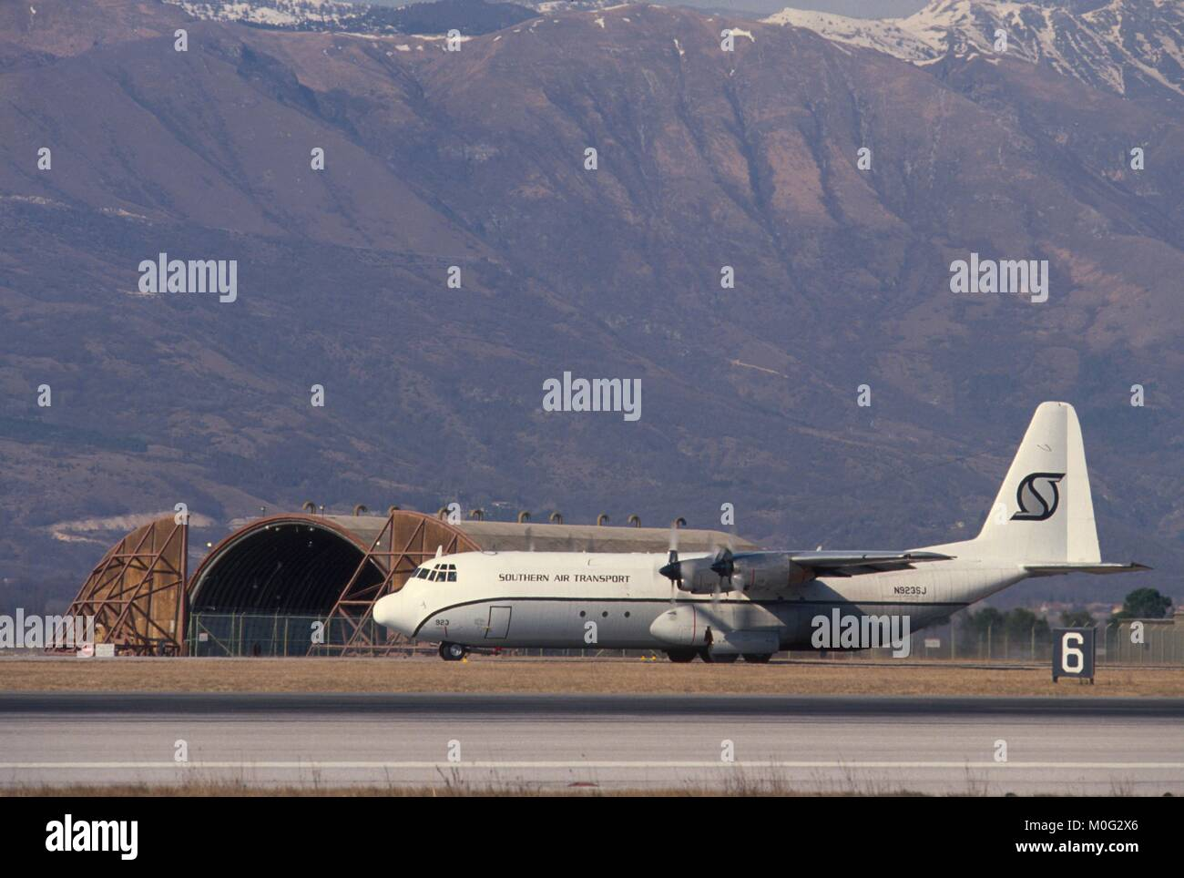 C 130 transport aircraft of the civil company Southern Air Transport in the US Air Force base of Aviano (north Italy); - Stock Image