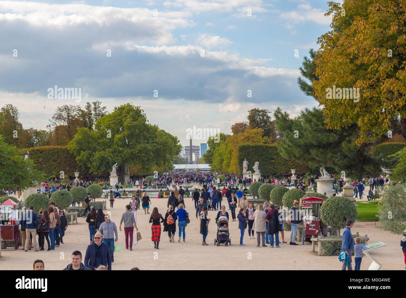 Unknown people strolling in the Jardin des Tuileries, Paris on a sunny September afternoon. - Stock Image