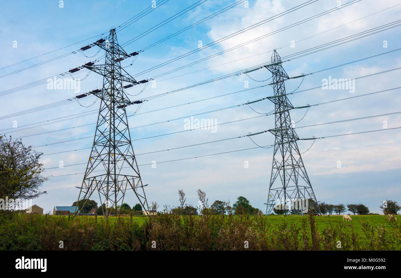 Electricity Pylons in the countryside. - Stock Image