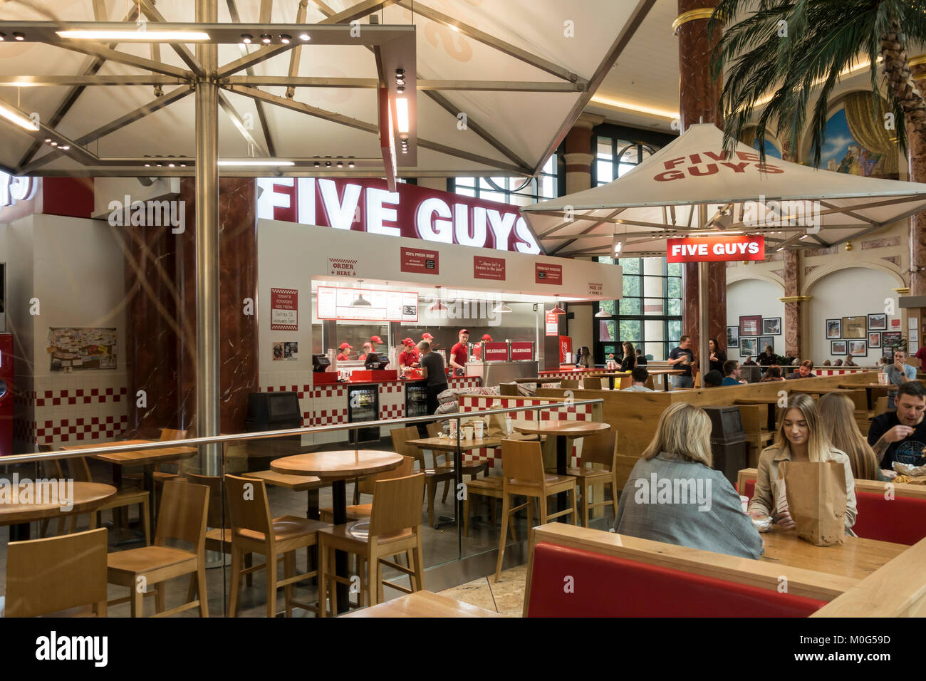 Five Guys fast food outlet in the Orient Food Court, intu Trafford Centre, Manchester, England. - Stock Image