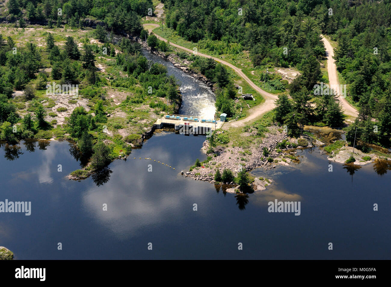 This is an aerial photograph of the portage dam which controls the flow of water between lake Nipissing and the - Stock Image