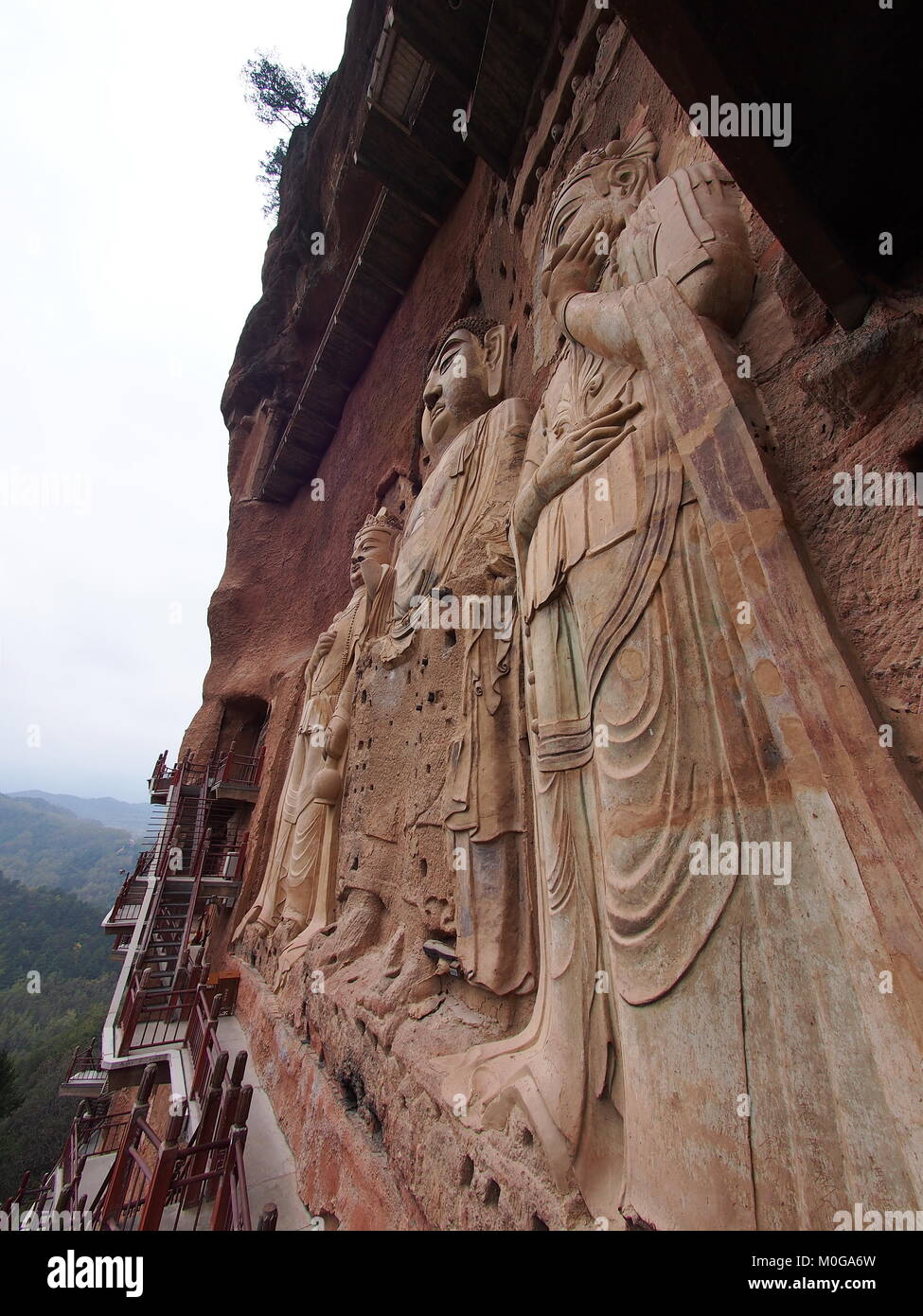 Maiji Shan Stone Mountain with ancient buddhist carving statue. Travel in Tianshui, Gansu, China. In 2013, October - Stock Image