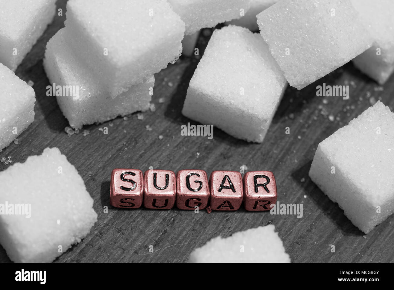 Sugar cubes with the word sugar on beads - Stock Image