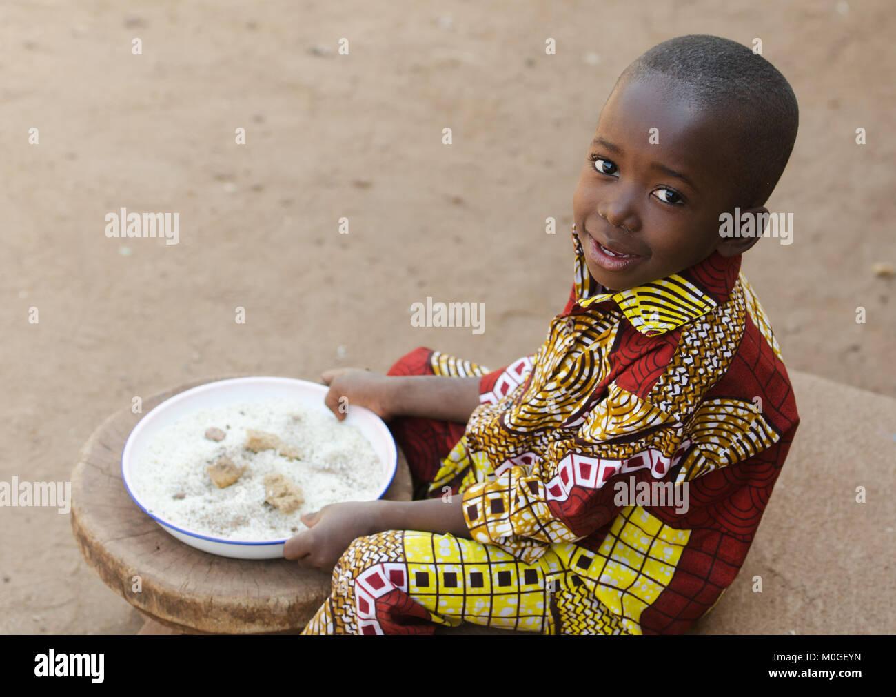 Eating in Africa - Little Black Boy Hunger Symbol - Stock Image