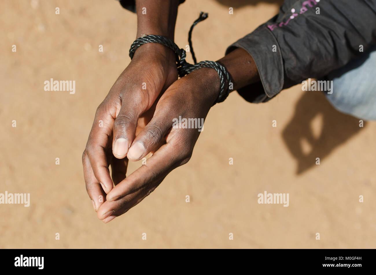Black Man Slave Refugee Symbol - Human Rights Issue - Stock Image