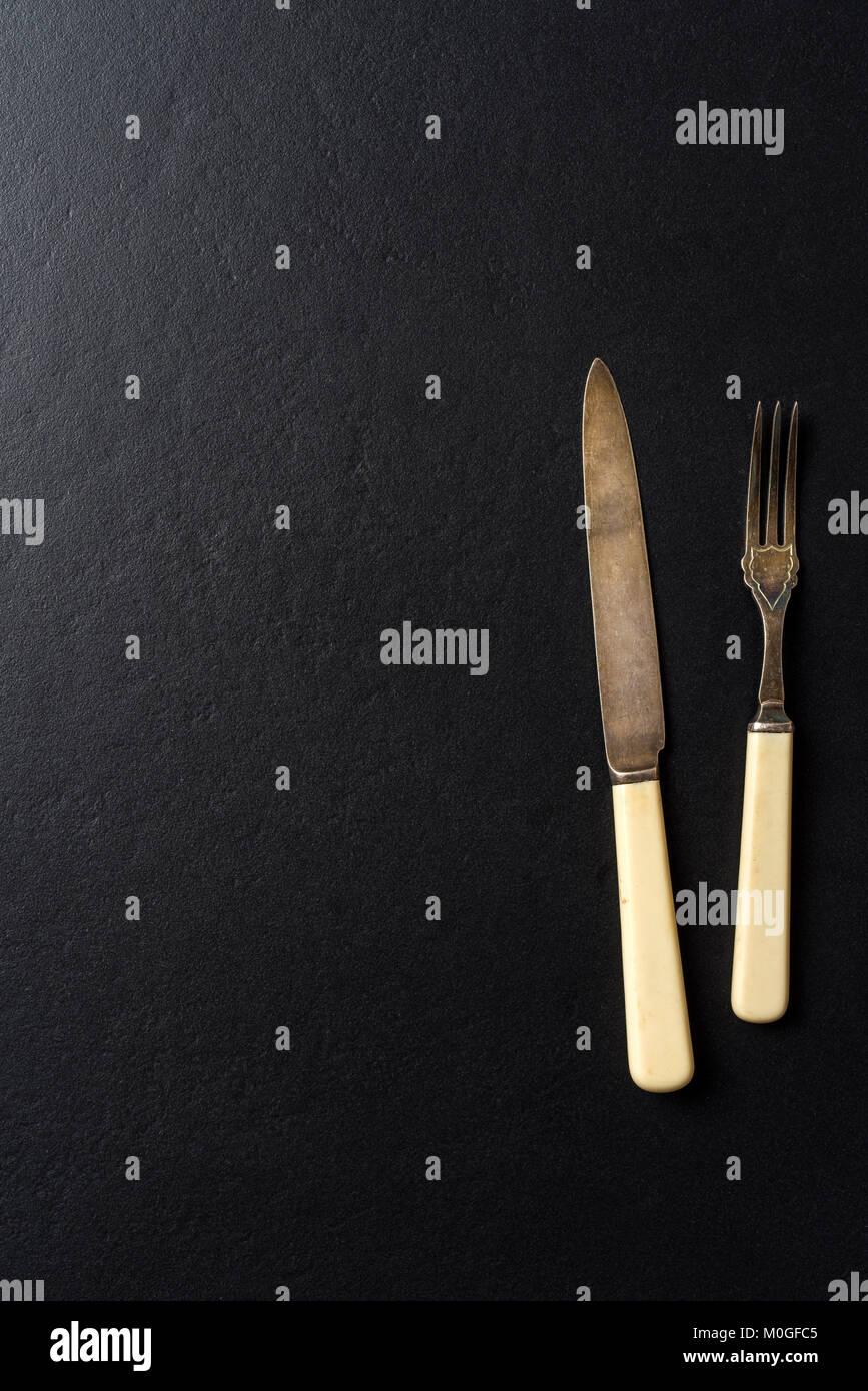 Kitchen utensils over black elegant background - Stock Image