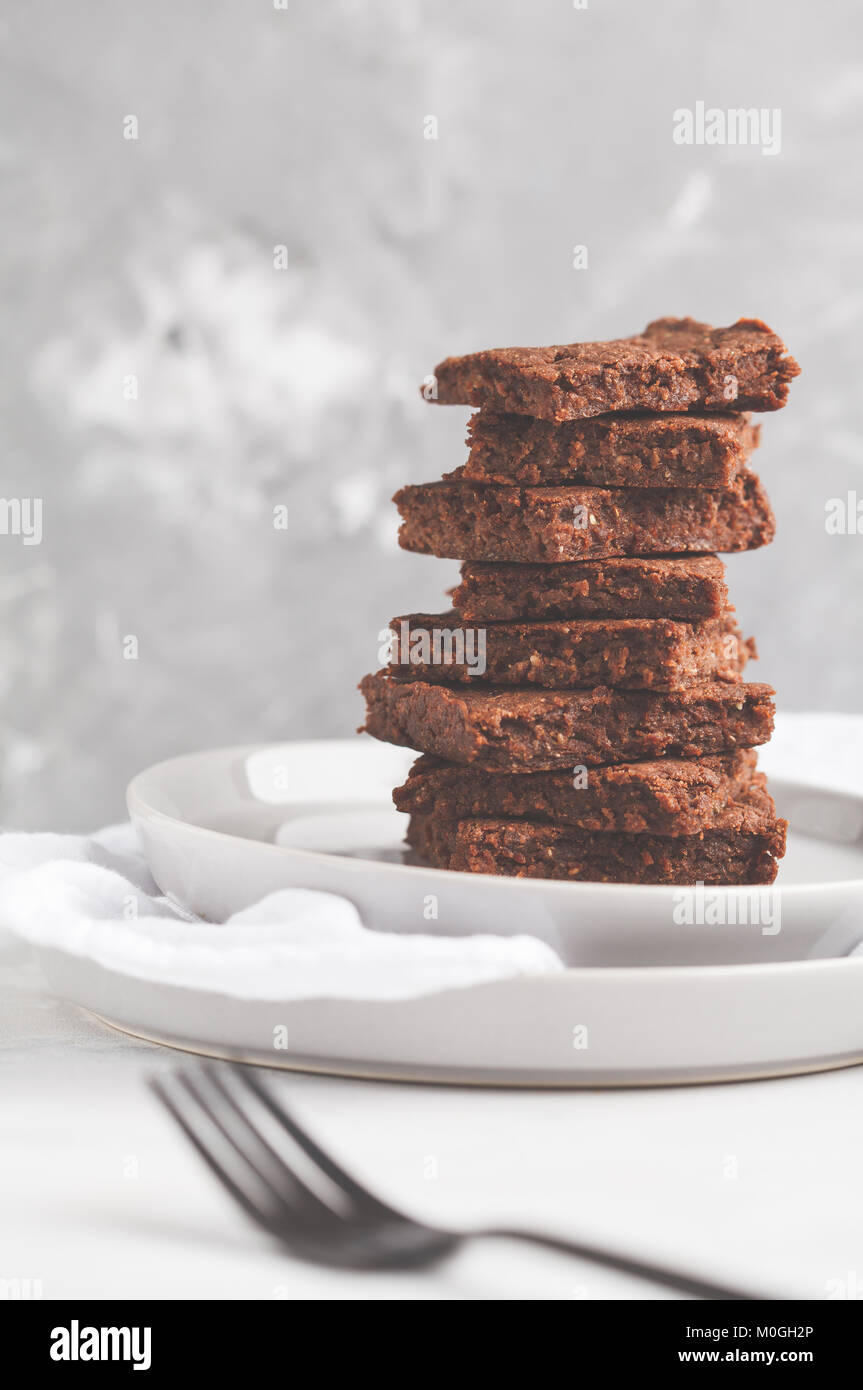 stack of slices of healthy vegan brownies. Healthy dietary vegan dessert concept. Stock Photo