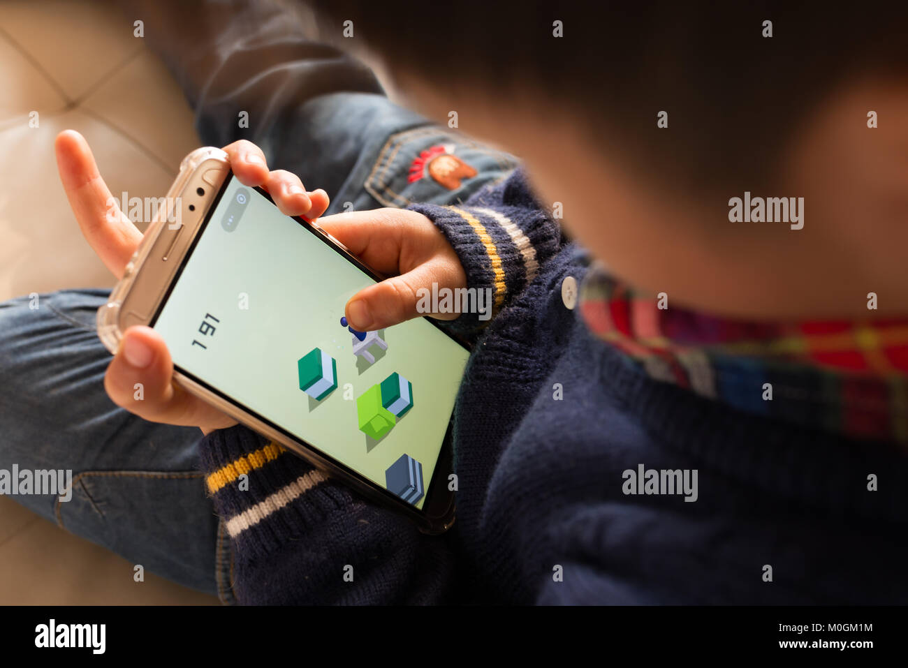 Zhongshan,China-January 22,2018:kid playing mobile game