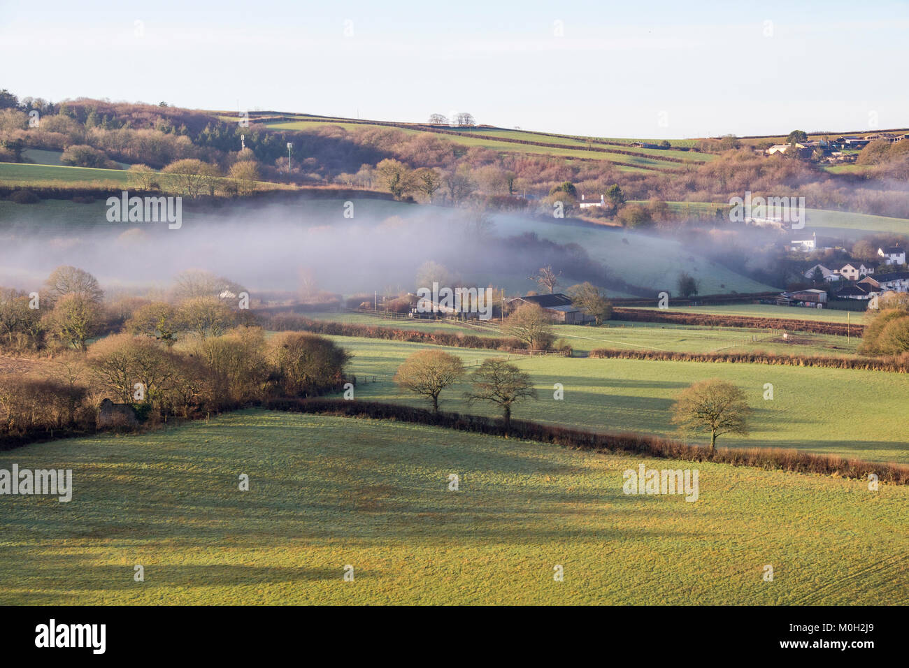 Misty Torridge Valley View: Looking from Torrington Across the River Valley Towards Taddiport, With Shadows and - Stock Image