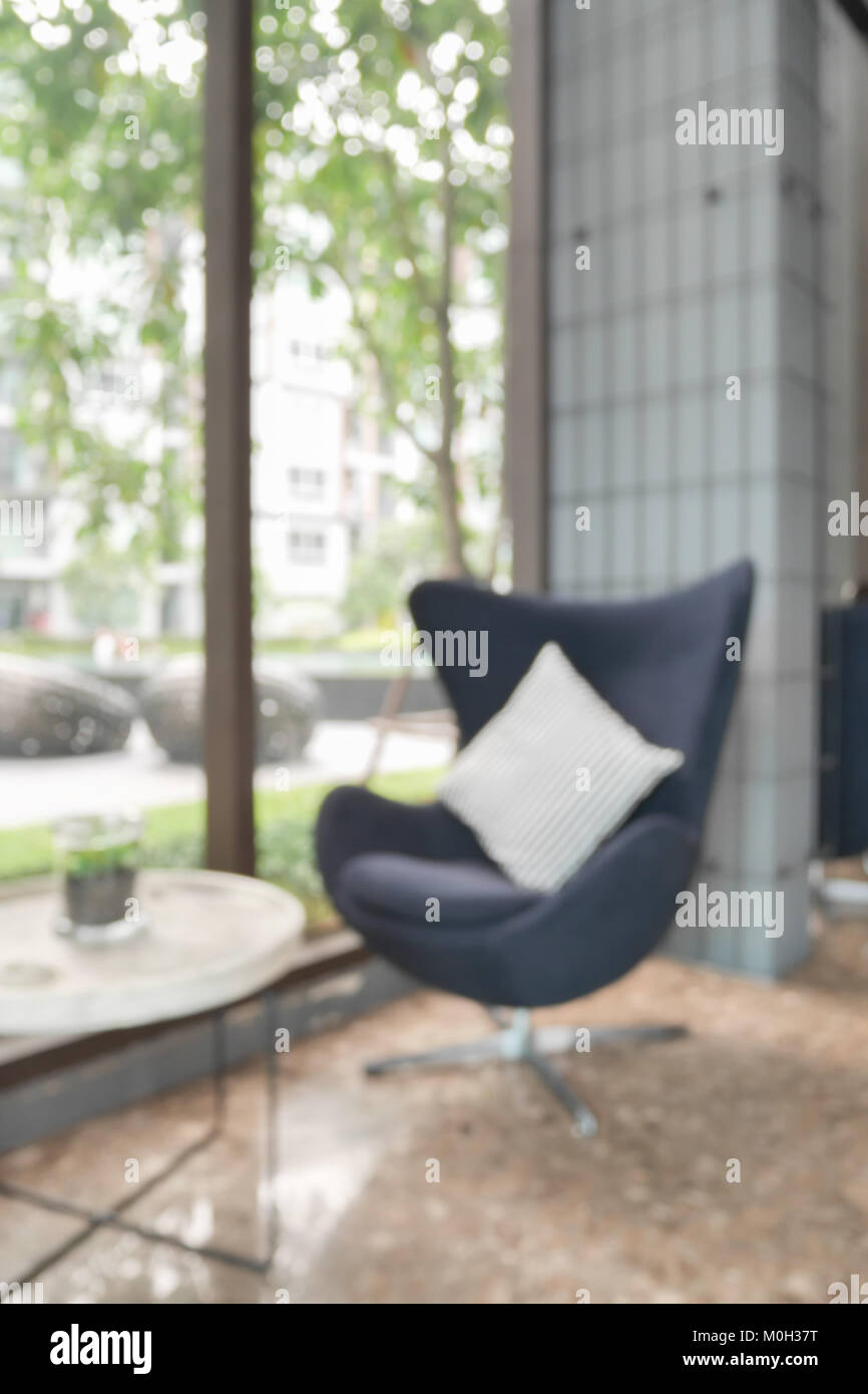 defocus background easy lounge chair at hotel lobby stock photo