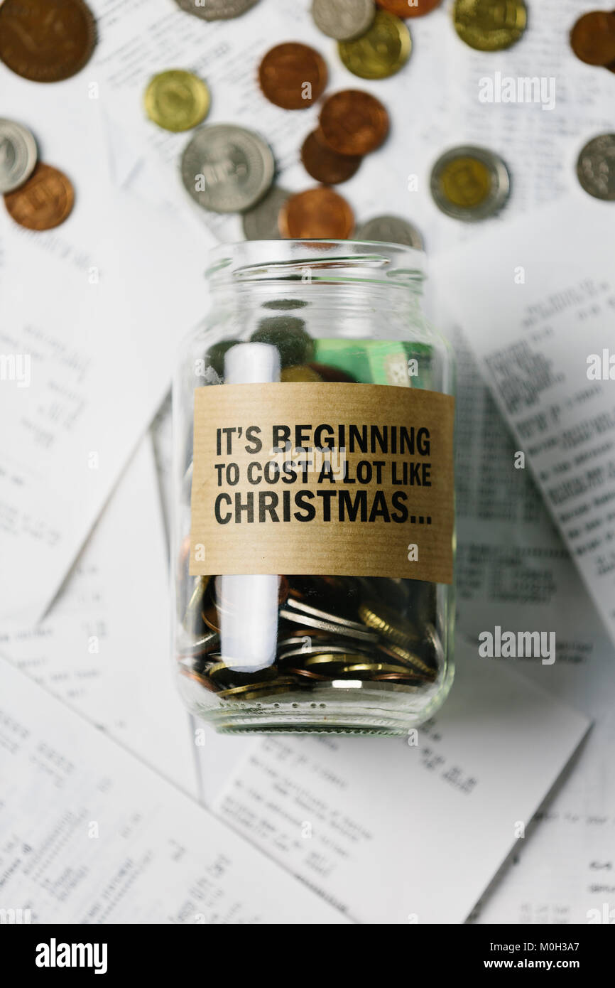 Series about money (play on words to the popular Xmas Song, 'It's beginning to feel a lot like Christmas') - Stock Image