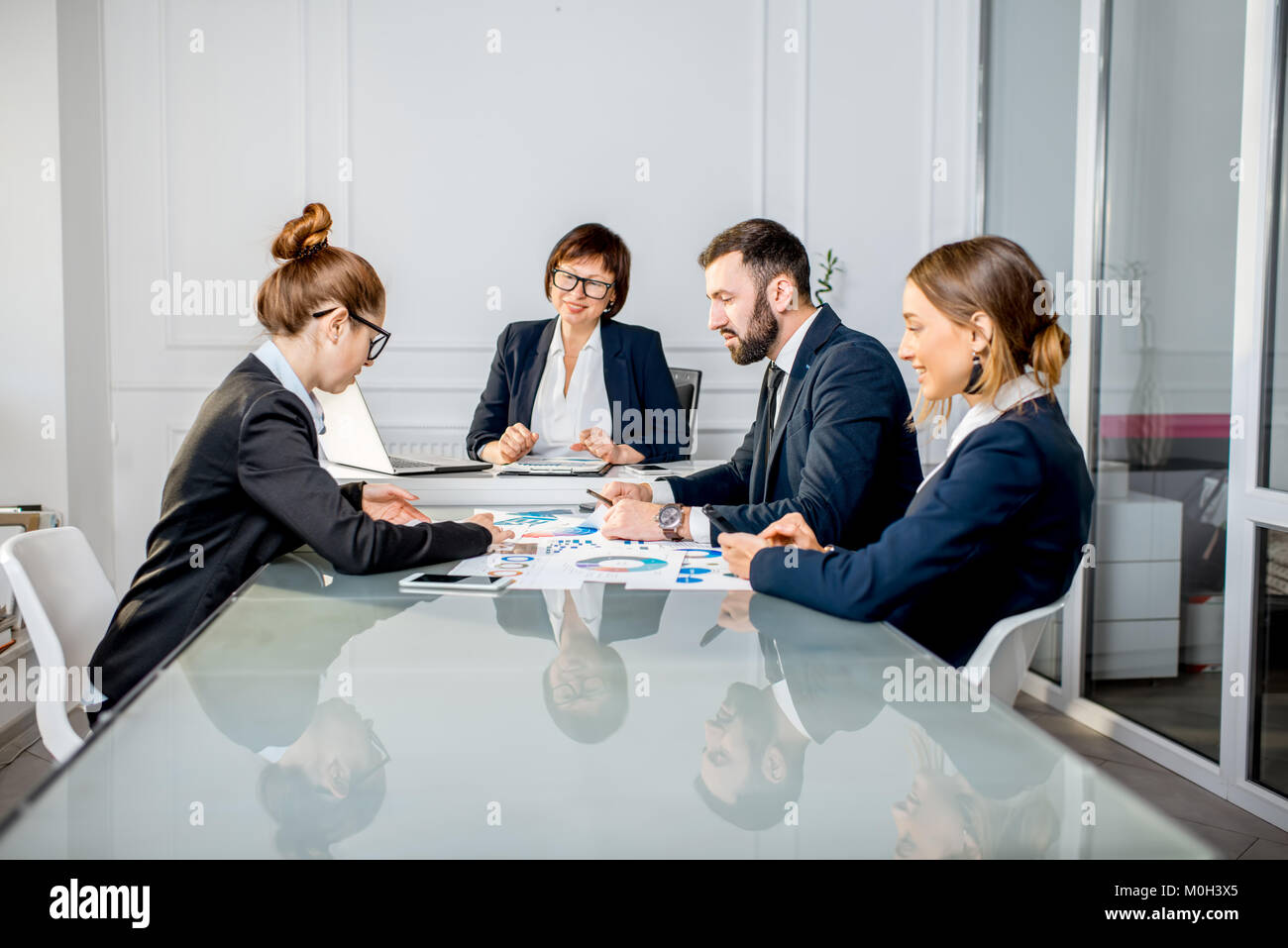 Business people during the conference in the office - Stock Image