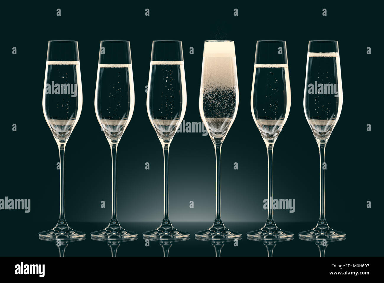 six transparent glasses with champagne on black - Stock Image