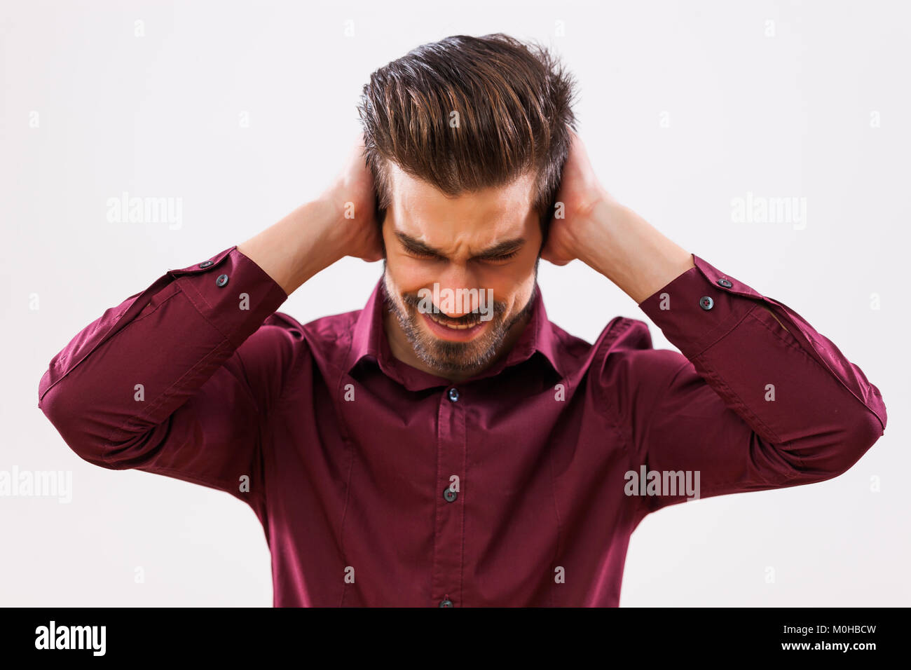 Portrait of young businessman who is under stress. - Stock Image