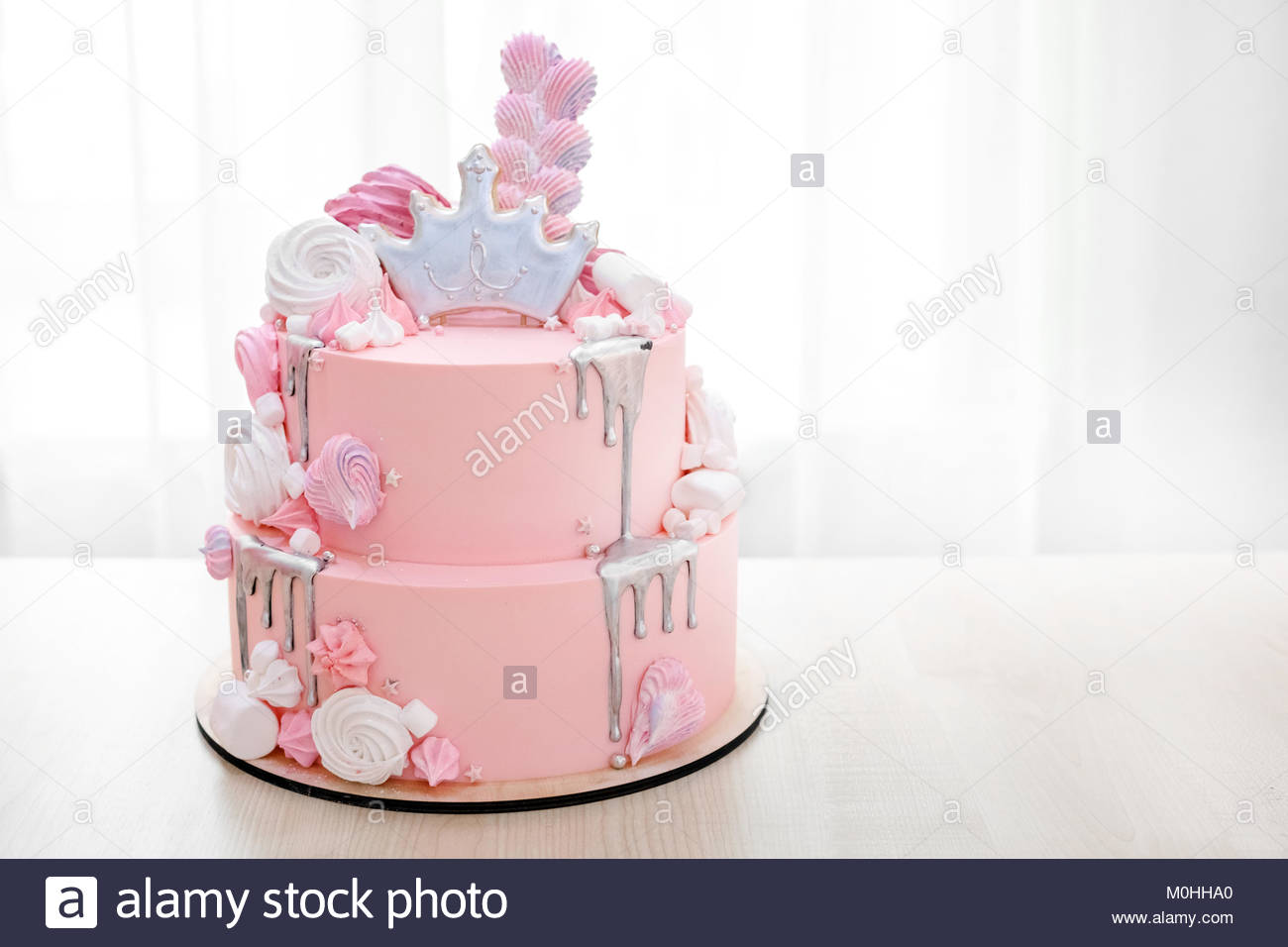 Pink marble cake with marshmallows on a plate close-up & Pink marble cake with marshmallows on a plate close-up Stock Photo ...