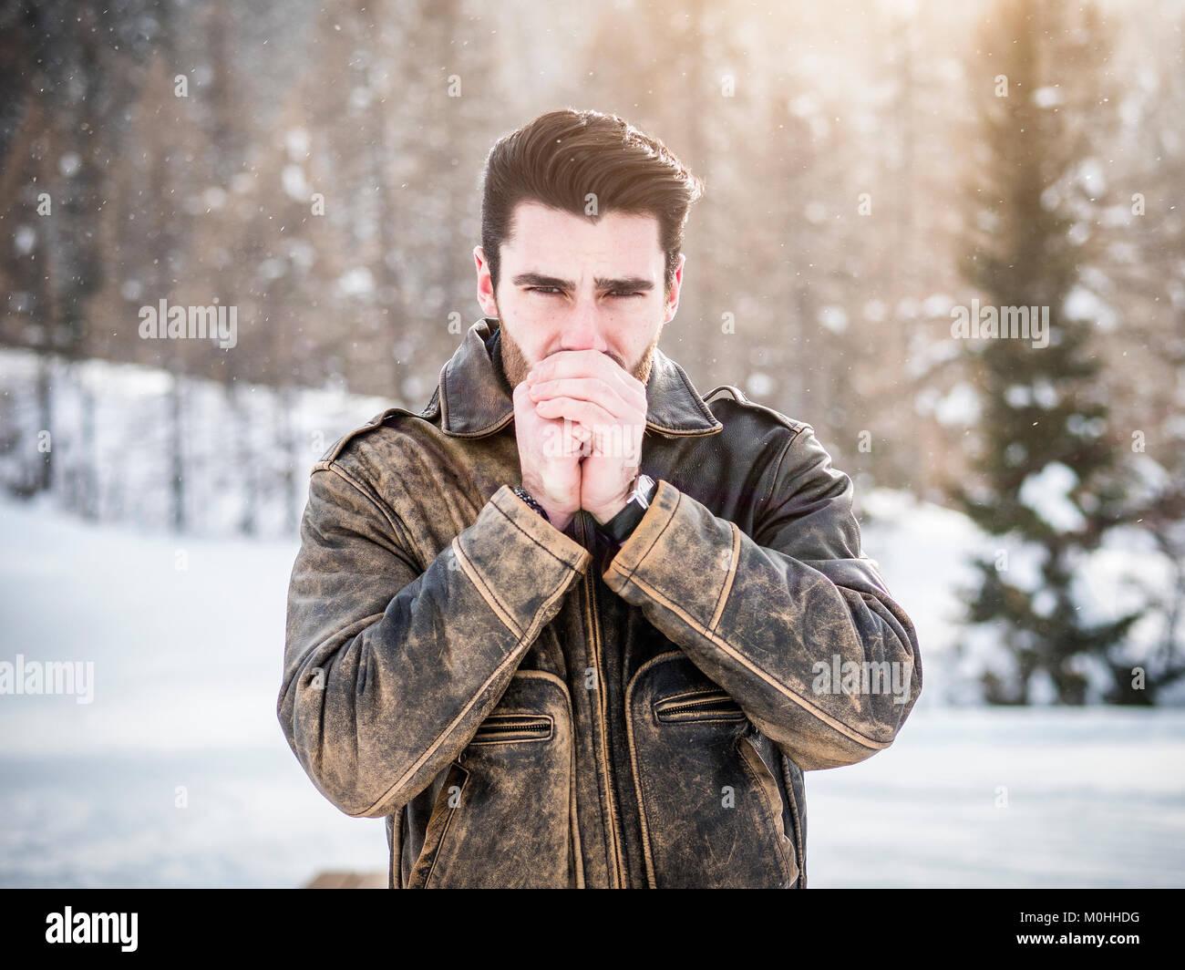 Male Model Posing In Snow Stock Photos & Male Model Posing