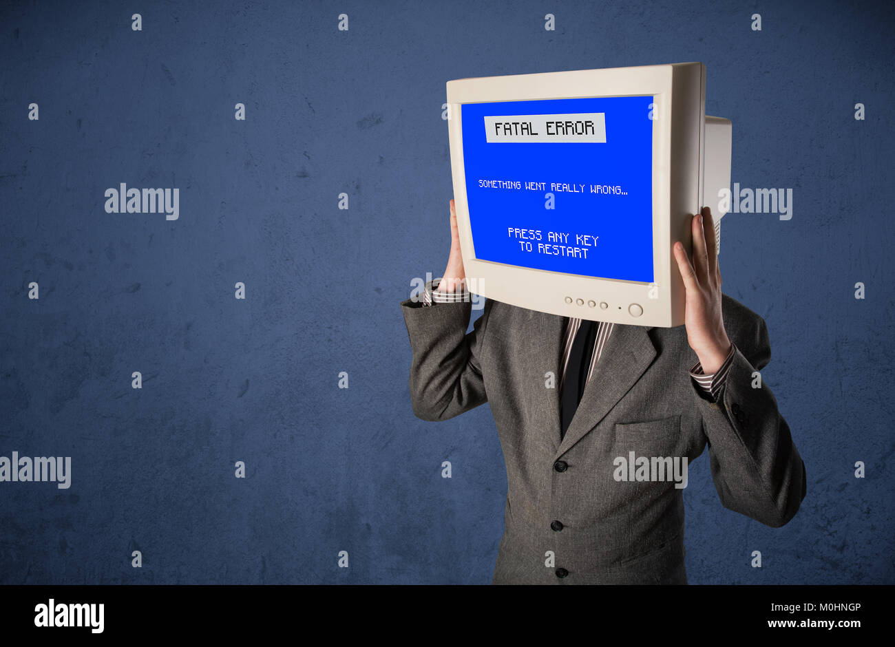 Person with a monitor head and fatal error blue screen on the display - Stock Image