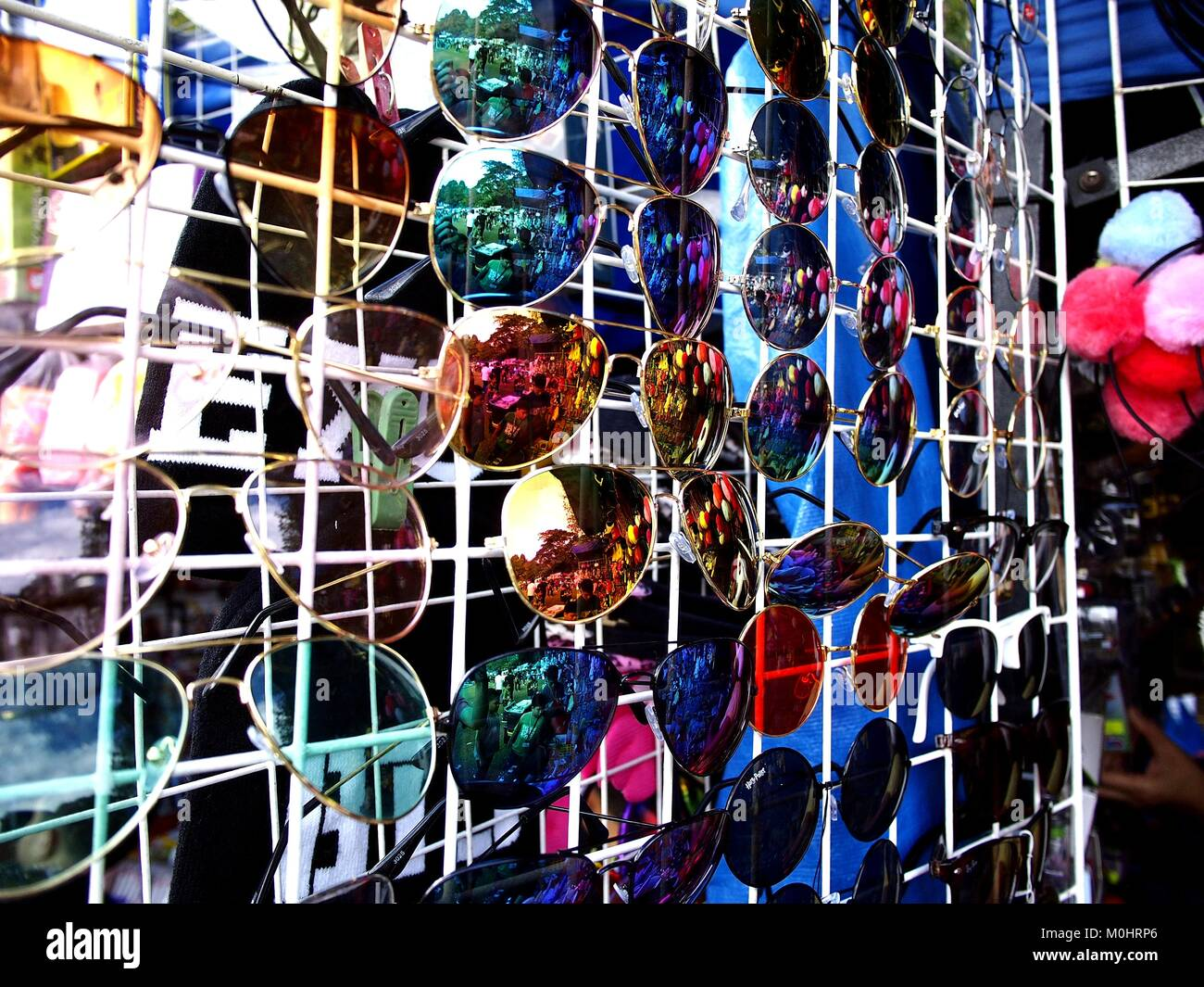 Photo of assorted eyewear on display at a bazaar store - Stock Image