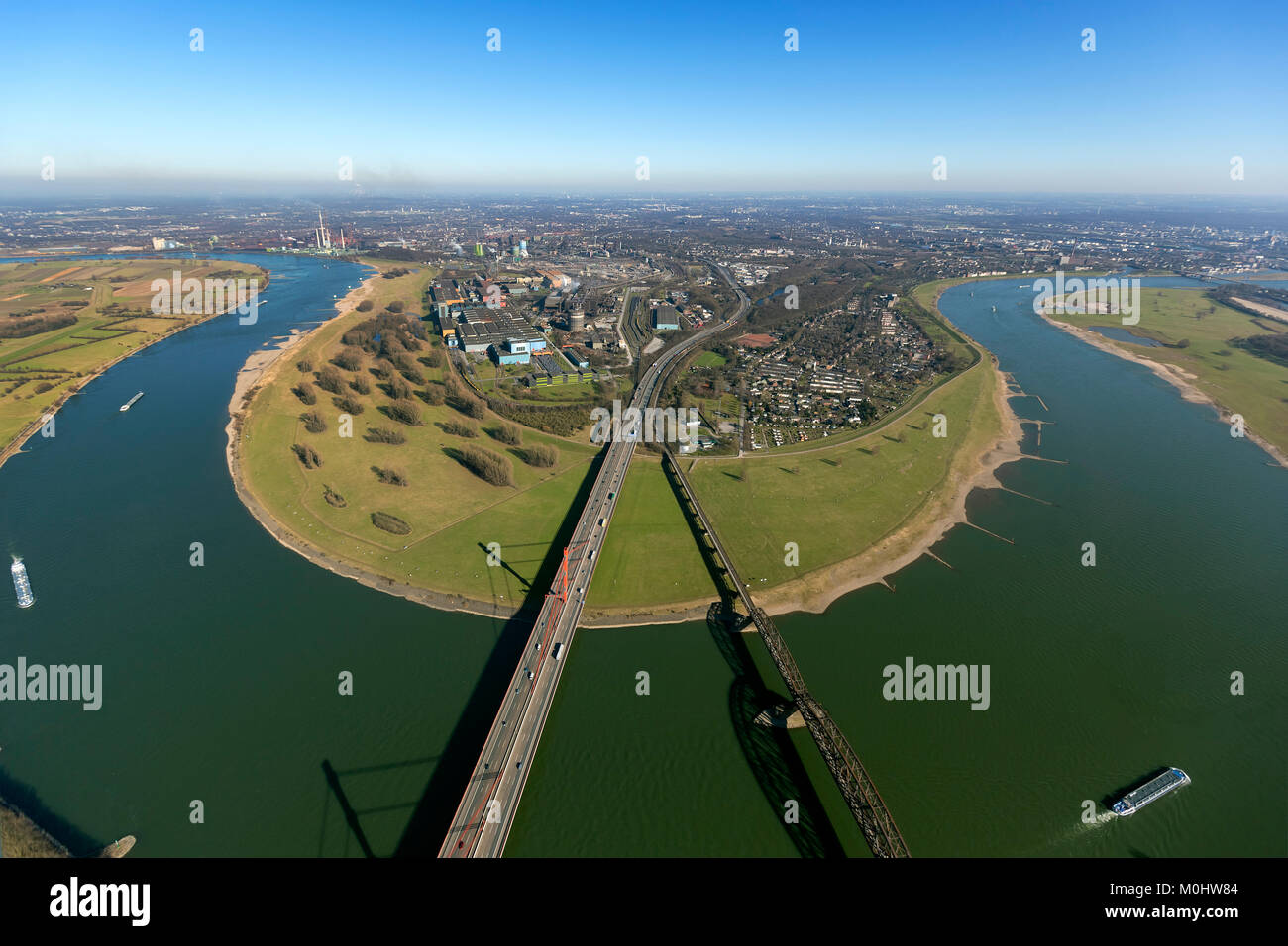 Aerial view, Rhine bend Beeckerswerth, Rhine, A42, motorway bridge over the Rhine, Thyssen steel mill, ThyssenKrupp - Stock Image