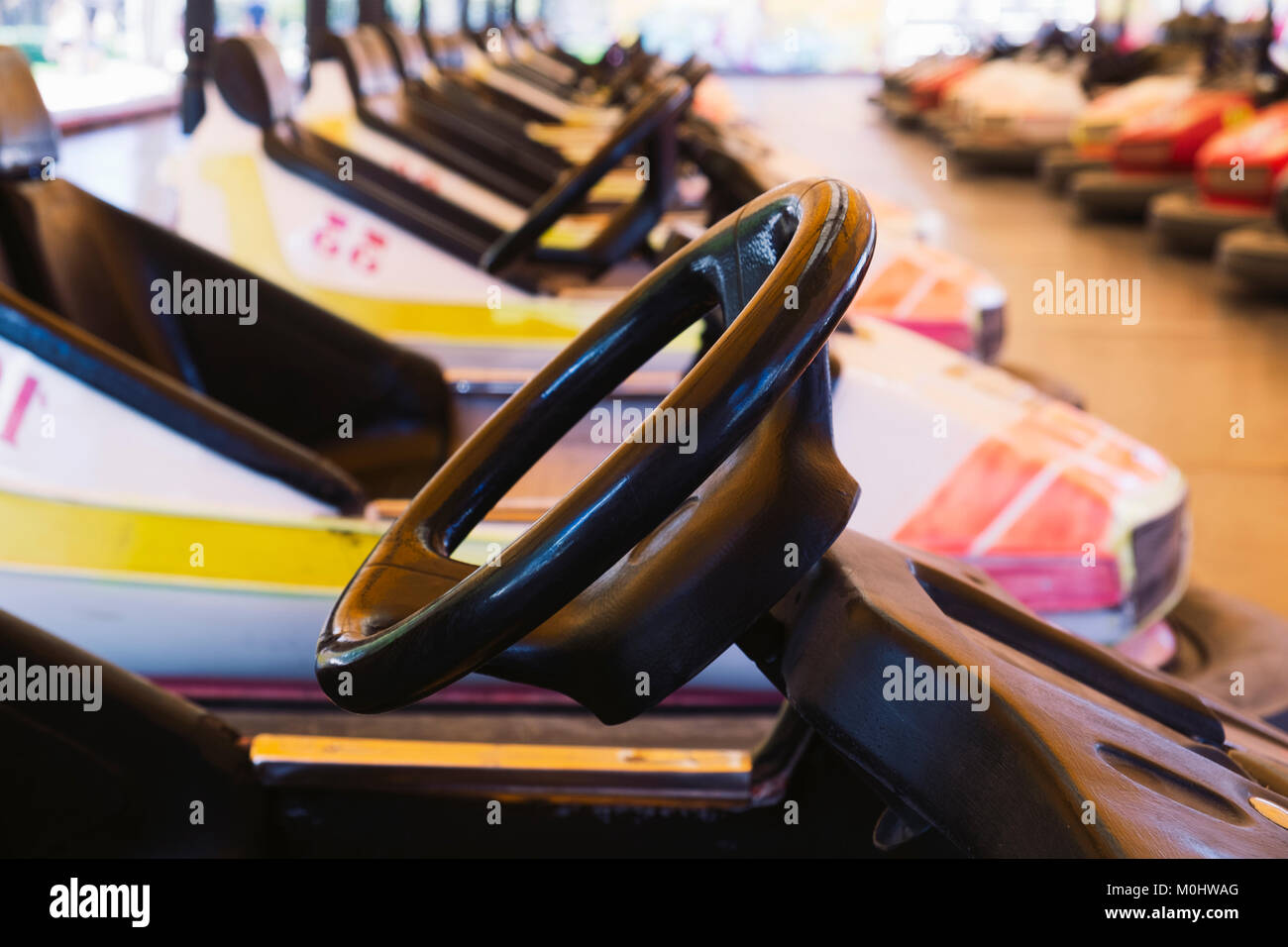closeup of some bumper cars parked in the track, in an amusement park - Stock Image