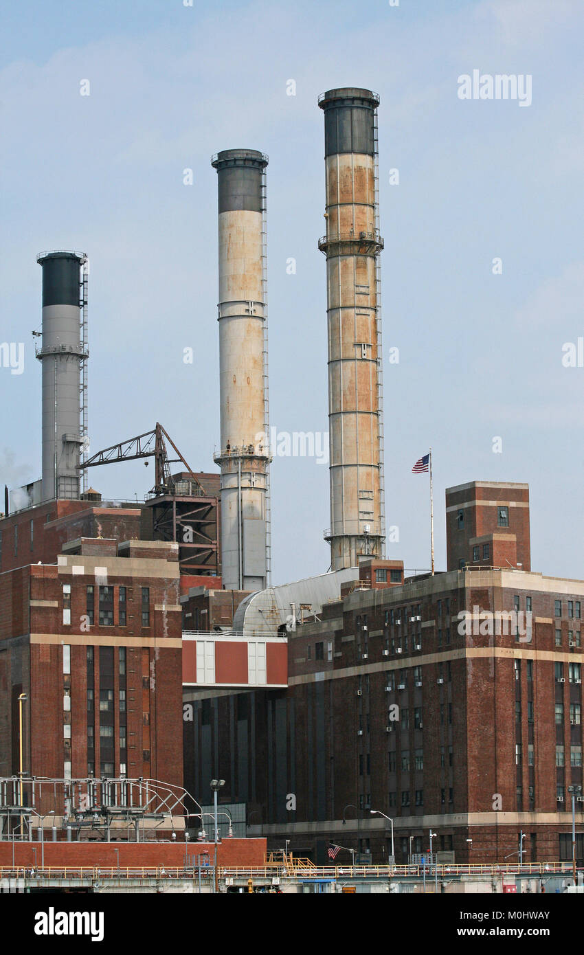 View of Consolidated Edison Inc. Power Plant from a ferry on the East River at 15th Street in Lower Manhattan, New - Stock Image