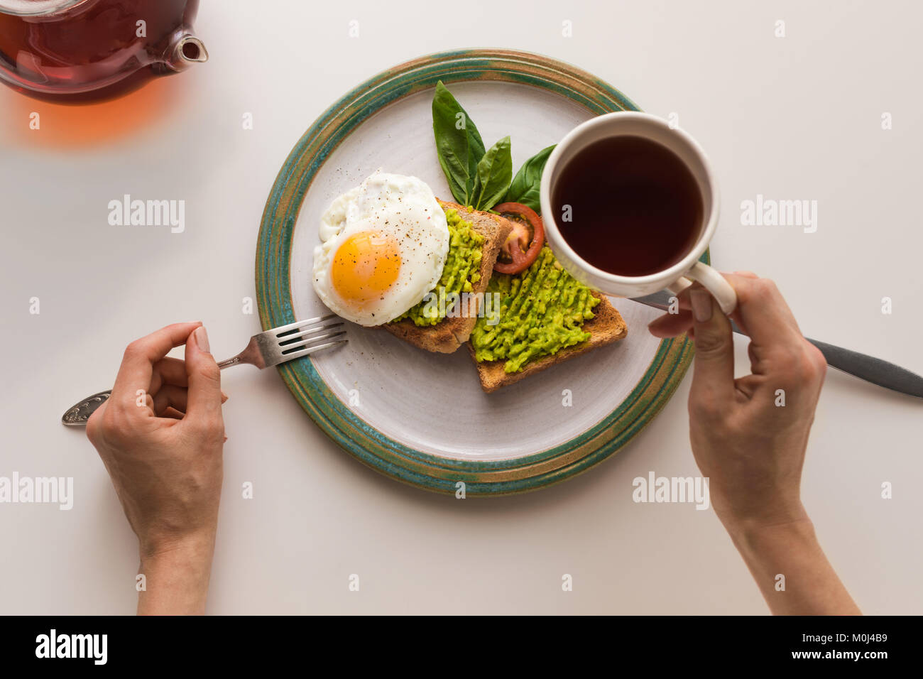 breakfast with tea and toasts - Stock Image