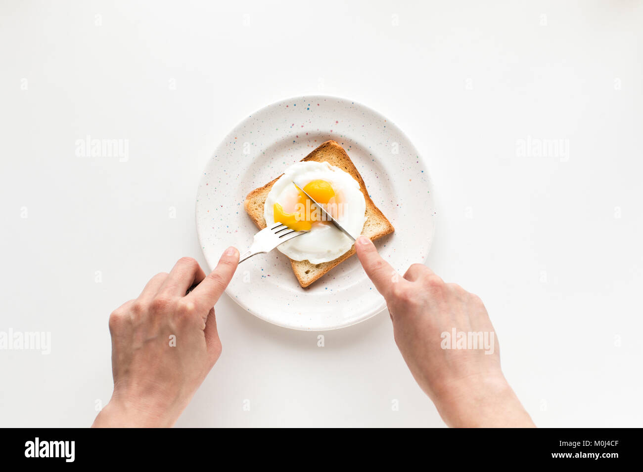 breakfast with fried egg on toast - Stock Image
