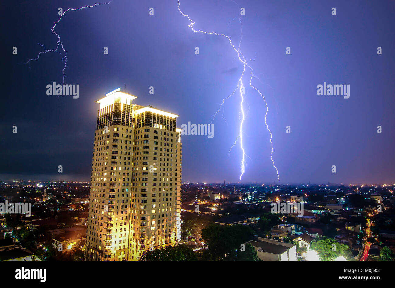 Lightning strike over a building in Jakarta, Indonesia Stock Photo