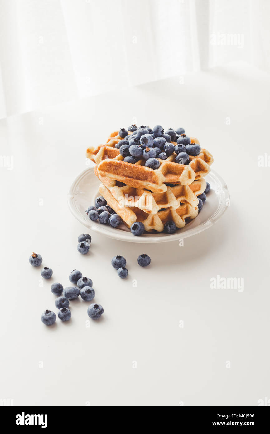 plate with stack of tasty fresh waffles with blueberries - Stock Image