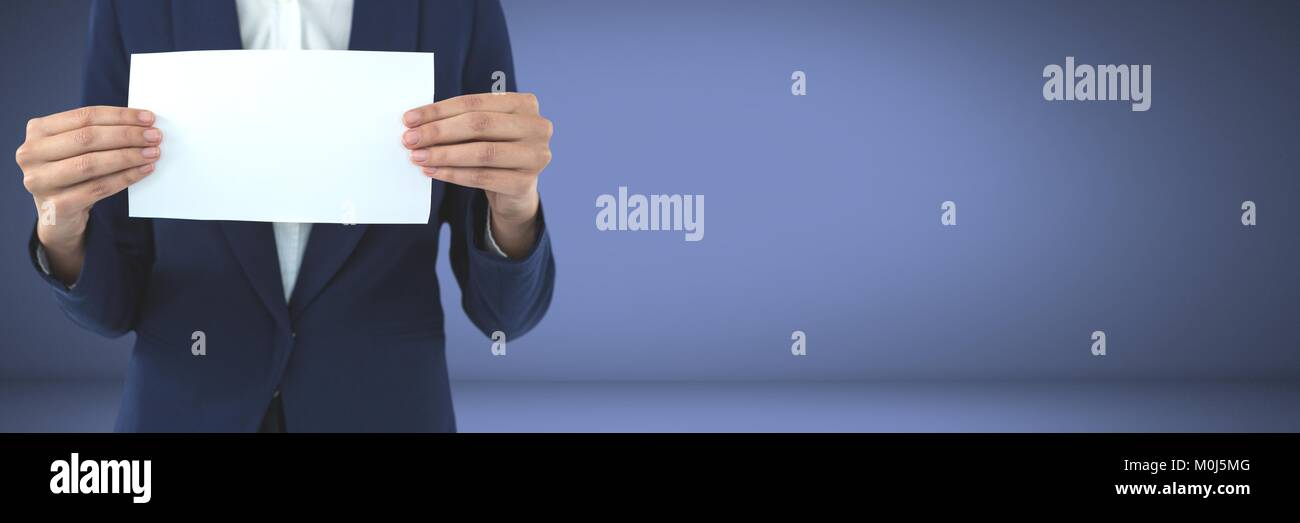 Businessperson holding blank card in hands - Stock Image
