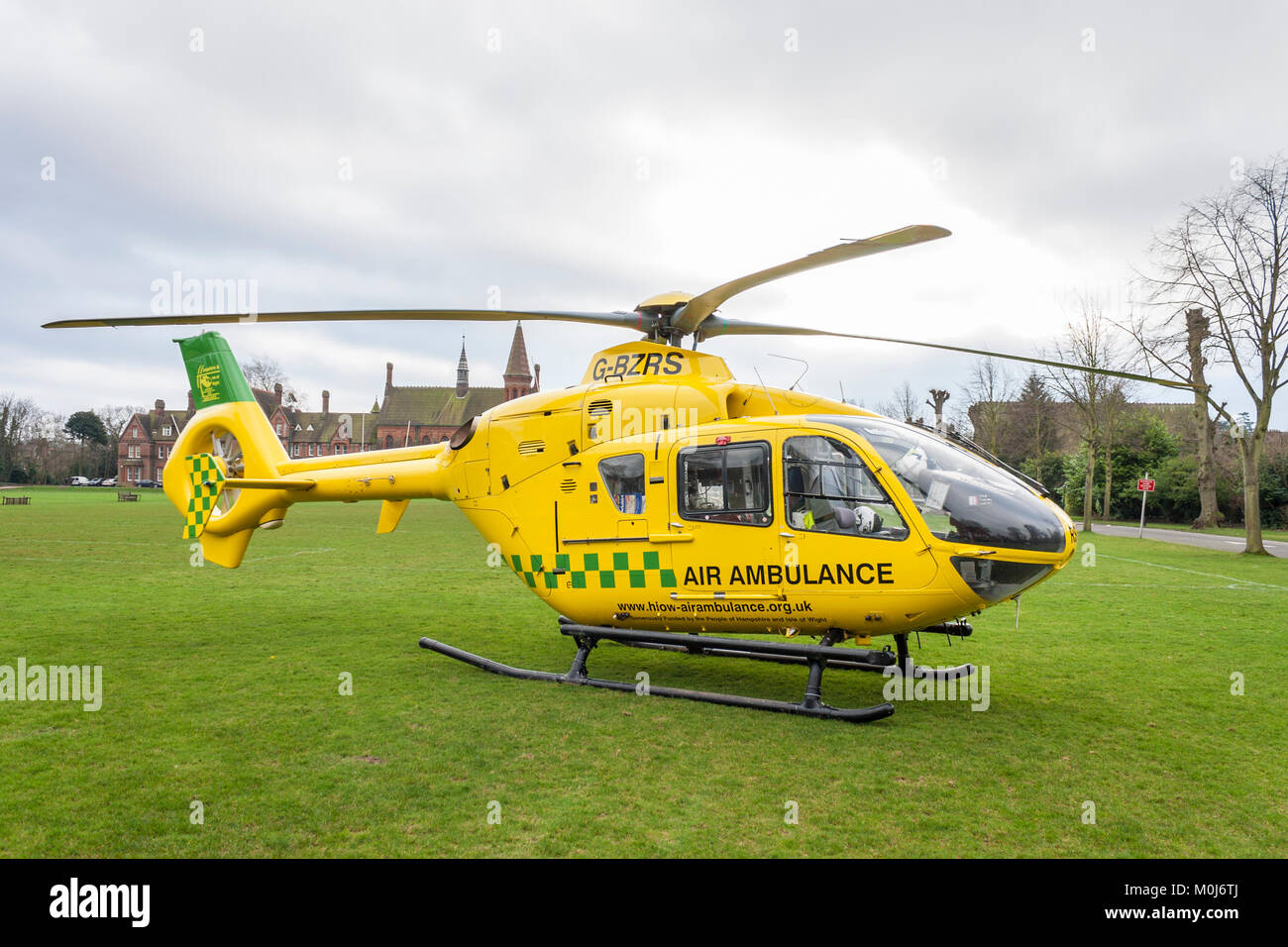 The Hampshire and Isle of Wight Air Ambulance helicopter, Eurocopter EC135, at Reading School to transfer a patient Stock Photo