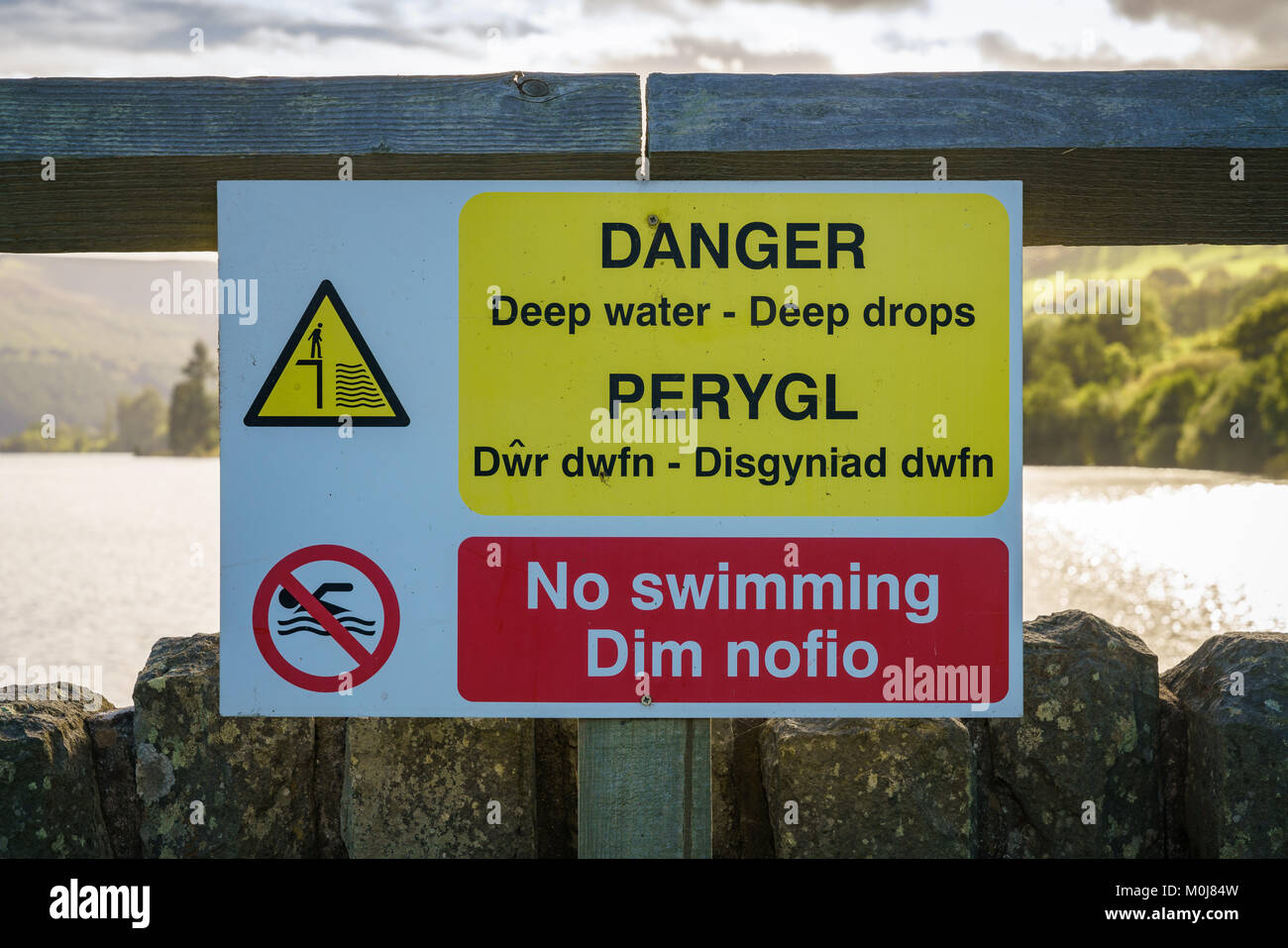 Sign: Danger deep water deep drops no swimming (Welsh & English), seen at the Talybont Reservoir Dam, Powys, - Stock Image