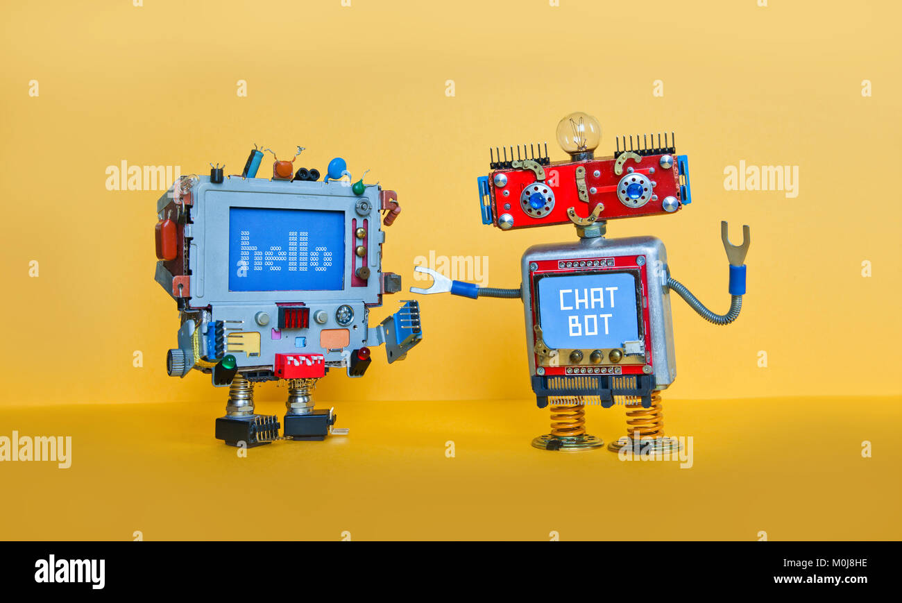 Chat bot robot welcomes android robotic character. Creative design toys on yellow background - Stock Image