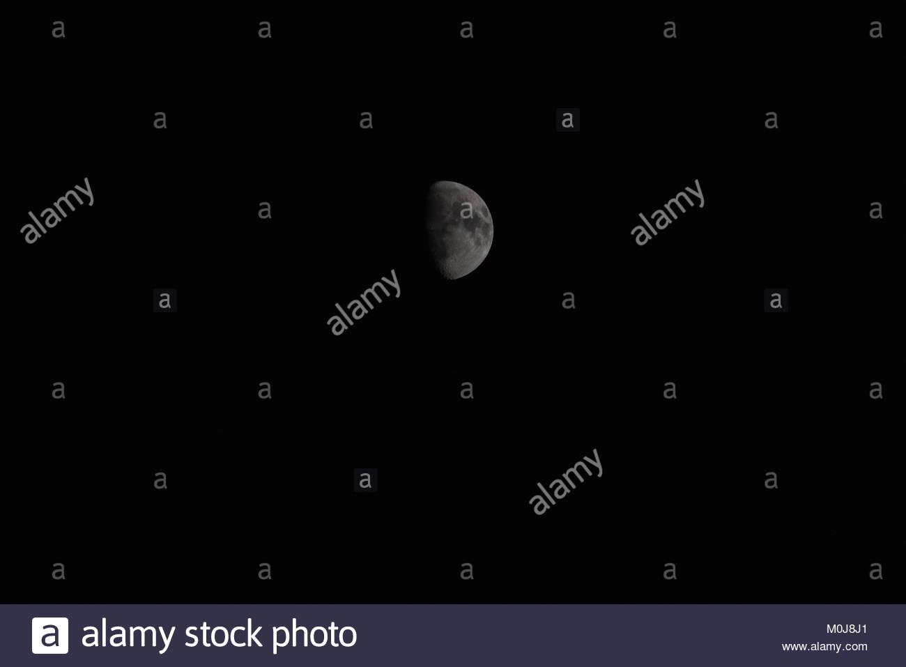 Half moon in the night. - Stock Image